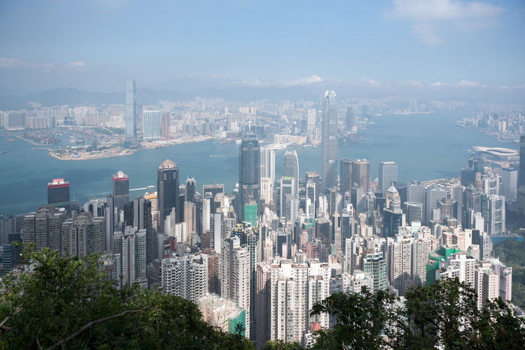 Hong Kong is an autonomous territory, and former British colony, in southeastern vibrant, densely populated urban centre is a major port and global financial hub with a skyscraper-studded (the business district) features architectural landmarks like 's Bank of China Kong is also a major shopping destination, famed for bespoke tailors and Temple Street Night Market. Architecture Bay Building Building Exterior Built Structure City Cityscape Financial District  Landscape Modern Nature No People Office Building Exterior Outdoors Residential District Sky Skyscraper Tall - High Tower Urban Skyline Water
