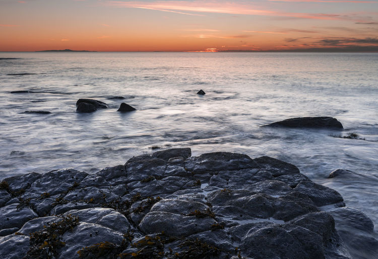 Sunset off the Cumbrian coast Sea Water Sky Sunset Rock Scenics - Nature Beauty In Nature Horizon Rock - Object Cloud - Sky Tranquility Power In Nature No People Idyllic Beach Land Wave Postcard Brochure Callander Canvas Weather Seascape Coast Dusk