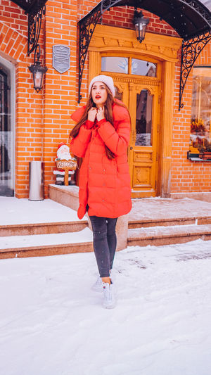 Beautiful happy smiling woman on the street in warm red winter coat on Christmas time on snowing. Winter Cold Temperature Warm Clothing Snowing Smiling Christmas Wintertime Woman Power women around the world EyeEm Best Shots EyeEm Colorful! Fashion Stories Red Lipstick One Person Full Length Front View Young Adult Clothing Snow Standing Real People Young Women Leisure Activity Happiness Women Adult Portrait Outdoors Scarf Beautiful Woman