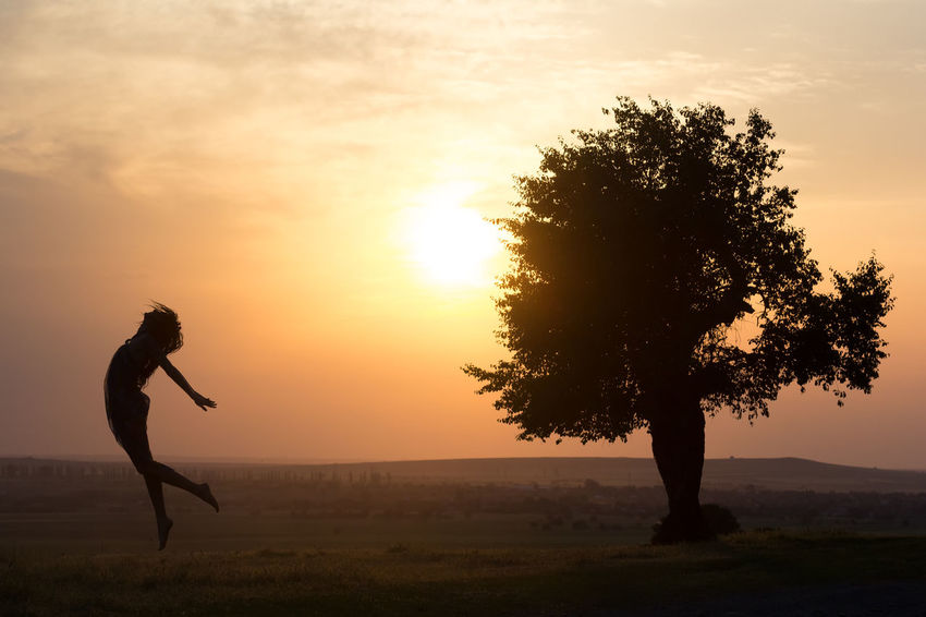 Exercise Freedom Happiness Summertime Beautiful Woman Beauty In Nature Cheerful Evening Female Fitness Flying Girl Healthy Jumping Lifestyles Nature One Person Orange Color Outdoors Pose Silhouette Sky Sunset Tree Young Women