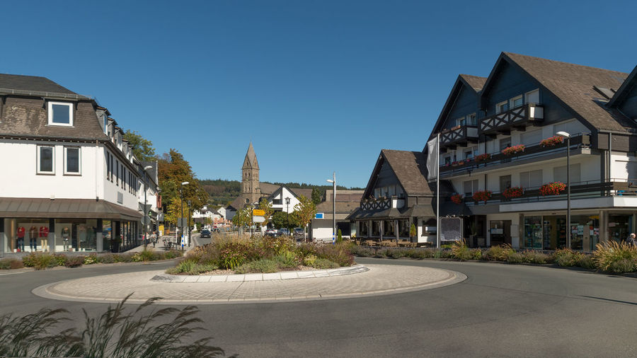 The city of olsberg photographed from the market. new traffic circle, shops, restaurant and  church