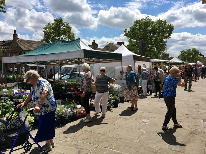 Market day in Skipton, Yorkshire England Yorkshire Skipton United Kingdom Market Stall Real People Cloud - Sky Group Of People Sky Building Exterior Sunlight Architecture Built Structure Day Plant Lifestyles Large Group Of People Crowd Enjoyment Leisure Activity