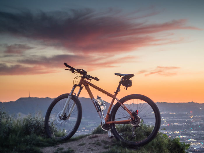 Up above the city Breathing Space MTB Adventure Aizan Beauty In Nature Bicycle Day Land Vehicle Mode Of Transport Nature No People Orange Color Outdoors Scenics Sky Stationary Sunset Transportation Voodoo
