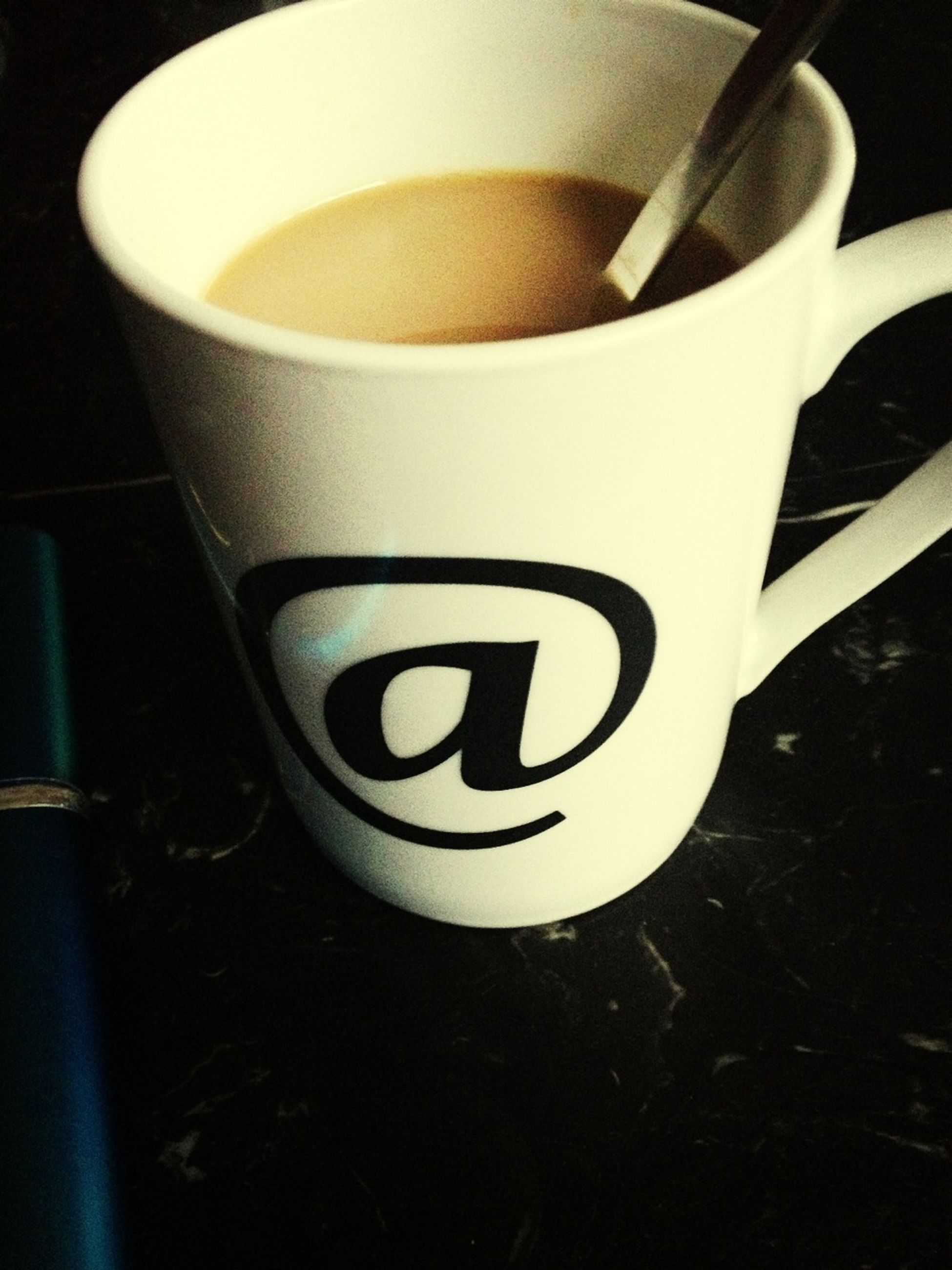 indoors, coffee cup, drink, table, close-up, still life, food and drink, high angle view, saucer, refreshment, coffee - drink, cup, coffee, no people, communication, white color, text, spoon, western script, focus on foreground