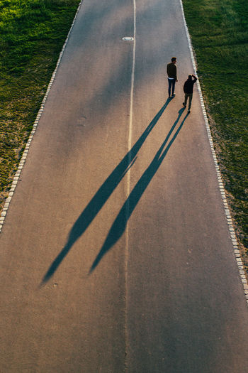 High angle view of men walking on road