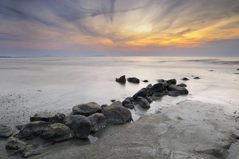 Black stone sunrise Sunrise Line Lead Water Sea Sunset Beach Low Tide Silhouette Social Issues Sun Summer Beauty Seascape Romantic Sky Dramatic Sky