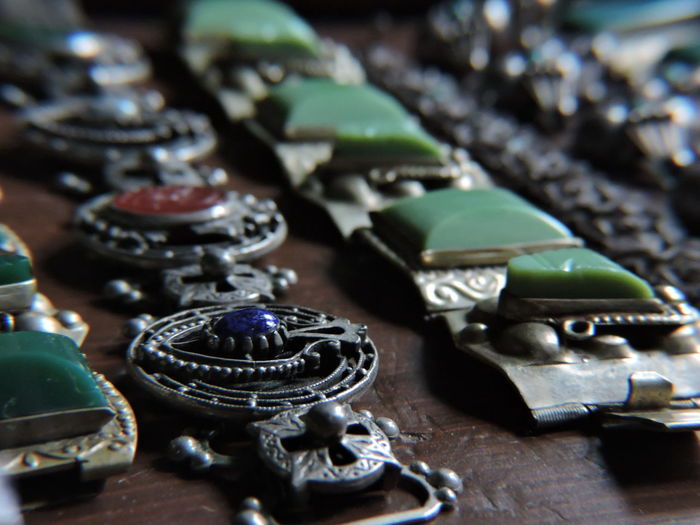 Close-up of antique jewelries on table