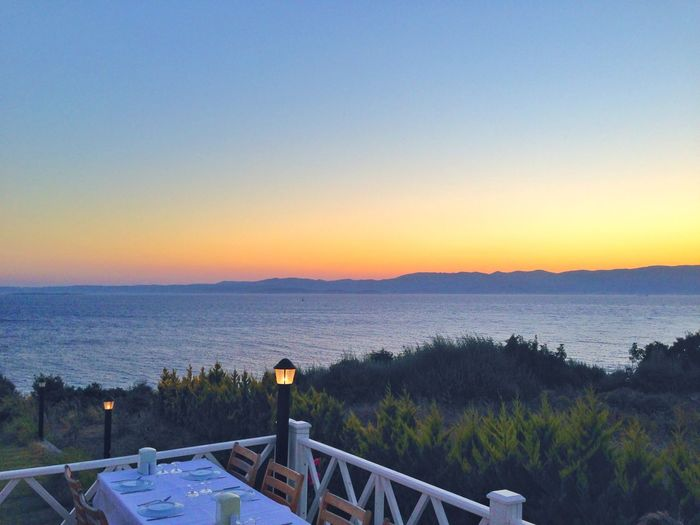 Idyllic shot of sea against sunset sky with place setting in imren restaurant
