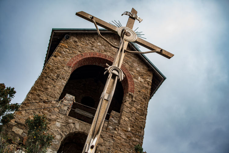 Stella Maris Alassio, Italy Low Angle View Sky Built Structure Architecture Religion Nature Belief Place Of Worship Cloud - Sky Spirituality Building Exterior No People Old Building Day Tree Cross Outdoors Alassio Alassio Liguria Italybeauty Stella Maris