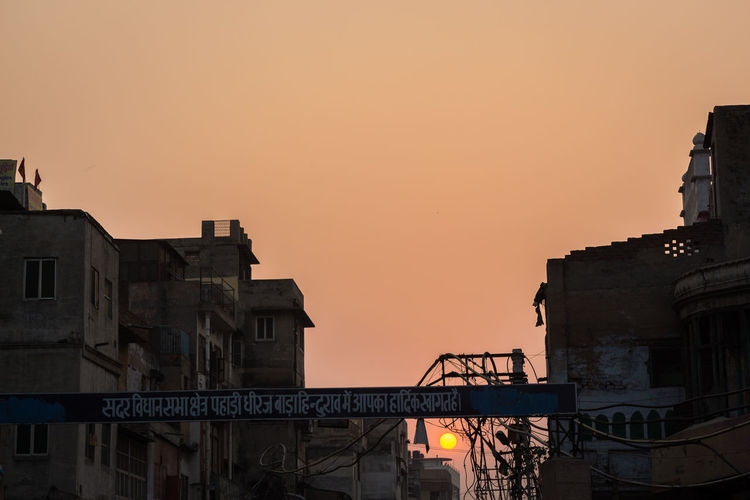 scene of sunset in building of old delhi, delhi, India Background City Street City View  Cityscapes Delhi Indiapictures Olddelhi Silhouettes Of A City Silouette & Sky Sun Sunandsky Sunset
