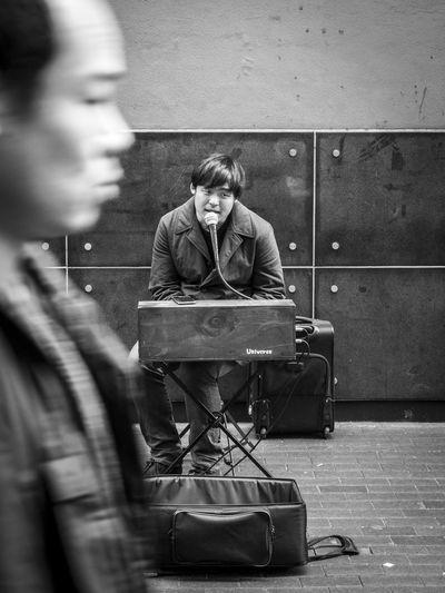 Street Musician, Mong Kok B&w Black And White Busker Busking City Life Keyboard Male Singer Mong Kok Monochrome Musician Passing Singing Sitting Street Street Musician Street Photography Streetphotography Urban Life Walk Pass Monochrome Photography