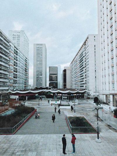 People in city against sky