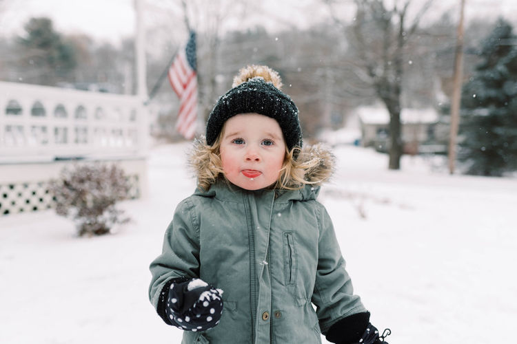 Portrait of cute girl in snow