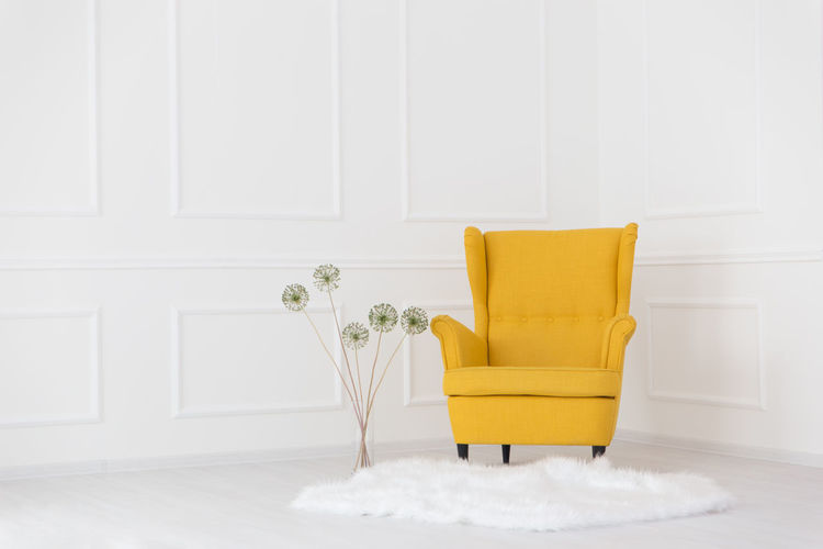 Yellow Armchair In Corner At Home