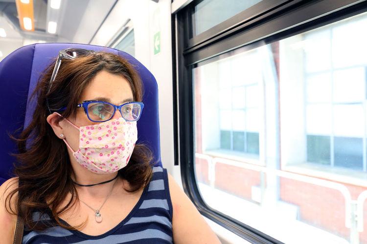 Portrait of woman in train