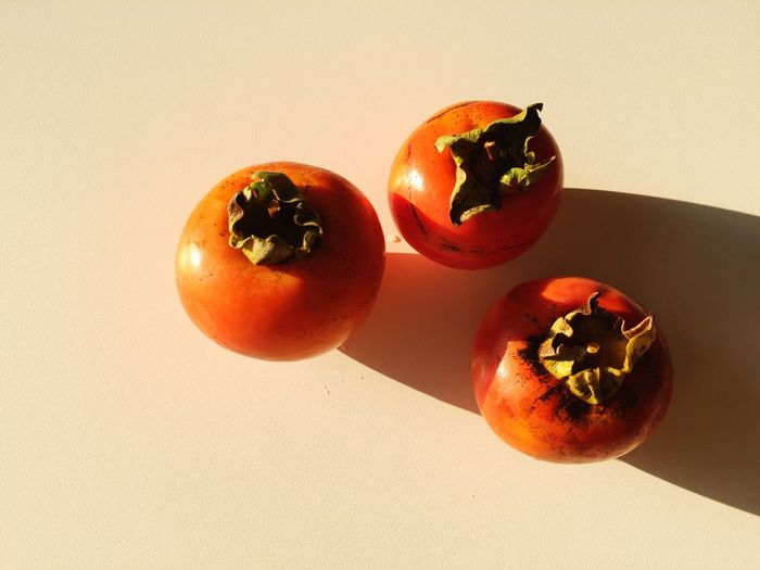 Close-up of persimmons on floor