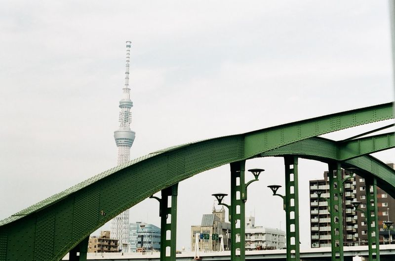 Low angle view of tokyo sky tree and bridge against sky in city