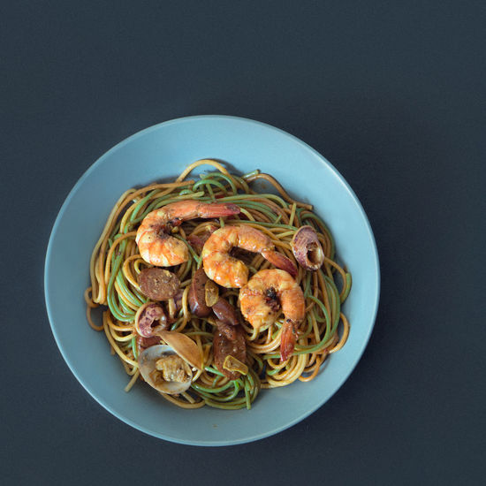 Pasta Plate Colourful Sausages Shrimp Black Background Blue Plate Close-up Food Indoors  No People Pasta Plate Plating Food Studio Shot Table