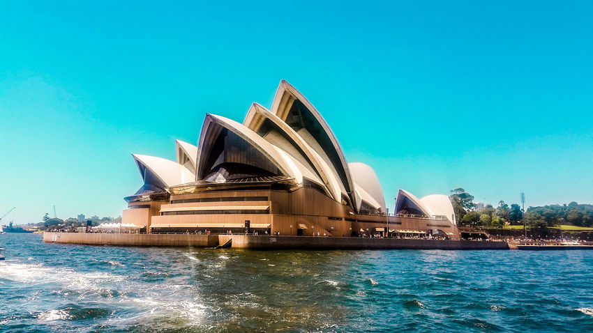 Travel Destinations Architecture Outdoors Modern Travel Sea Water City Building Exterior Cityscape No People Sky Arts Culture And Entertainment Blue Beauty Day Sydney Sydney, Australia Australia Opera House The Architect - 2017 EyeEm Awards EyeEmNewHere