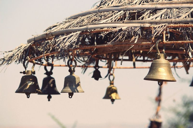 Close-up of bells hanging outdoors