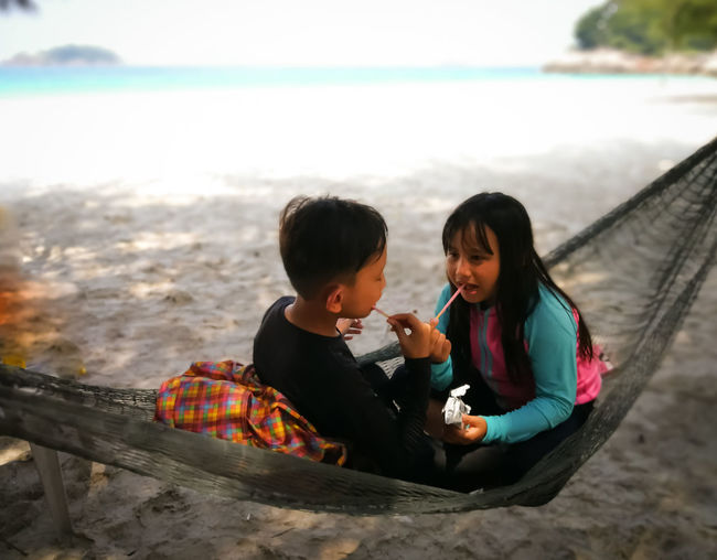 Pulau Redang, Terengganu. Water Togetherness Two People Childhood Child Bonding Real People Leisure Activity Sitting Family Beach Boys Lifestyles Land Sea Casual Clothing Nature Males  Innocence Outdoors Sister Positive Emotion