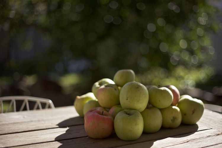 Autumn Fresh Produce Green Apples  Apples Autumn Fruit Close-up Day Focus On Foreground Food Food And Drink Freshness Fruit Green Color Healthy Eating Nature No People Outdoors Red Apples Table Tree Wood - Material Wooden Texture