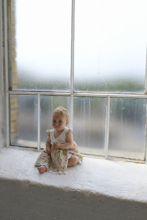 EyeEm Best Shots Baby Babyhood Child Childhood Cute Day Full Length Girl Glass - Material Indoors  Innocence Looking One Person Portrait Real People Sitting Toddler  Transparent Window Young
