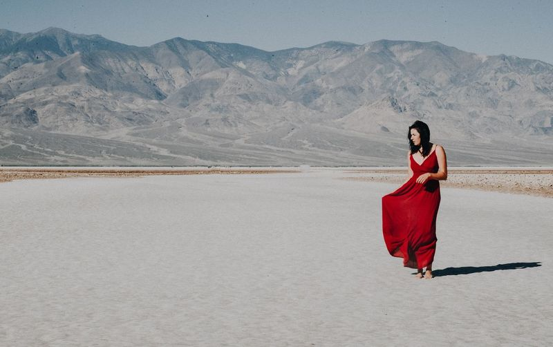 Woman in red Joy Adventure Strong Girl Badwater Basin Death Valley National Park Desert Beauty Roam Wild And Free Strength Grace Red Dress One Person Full Length Young Adult Adult Women Clothing Mountain Red Fashion Desert Young Women Real People Lifestyles International Women's Day 2019