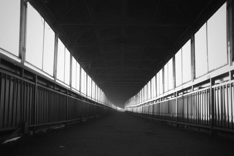 Empty road along bridge