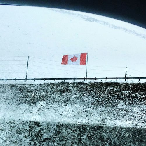 Outdoors Patriotism Water No People Day Sky Nature Winter Snow Cold Temperature Travel Road Windscreen Canada Canadian Canadian Flags In The Wind  Flag Canada Canadian Canadian flag CanadianFlag