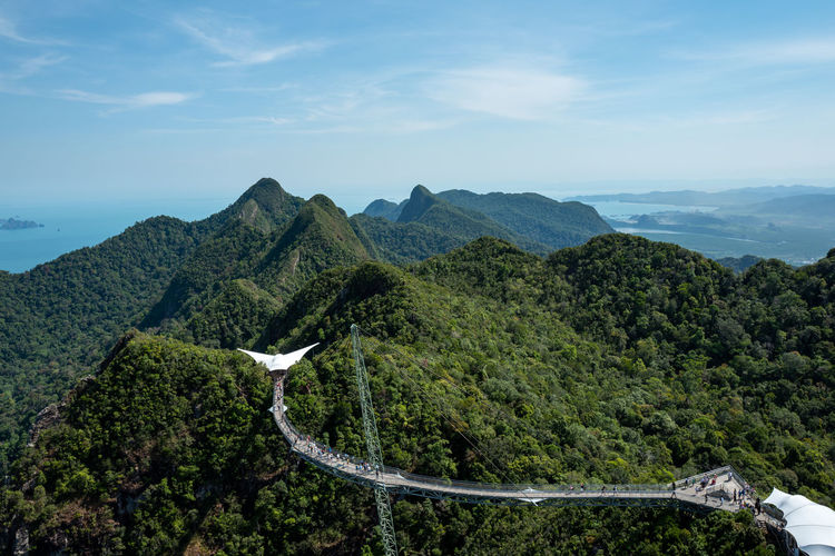 Langkawi Mountain Scenics - Nature Sky Beauty In Nature Mountain Range Tranquil Scene Tranquility Plant Environment Landscape Tree Non-urban Scene Nature Cloud - Sky Day No People Idyllic Green Color Road Transportation Outdoors Skybridge