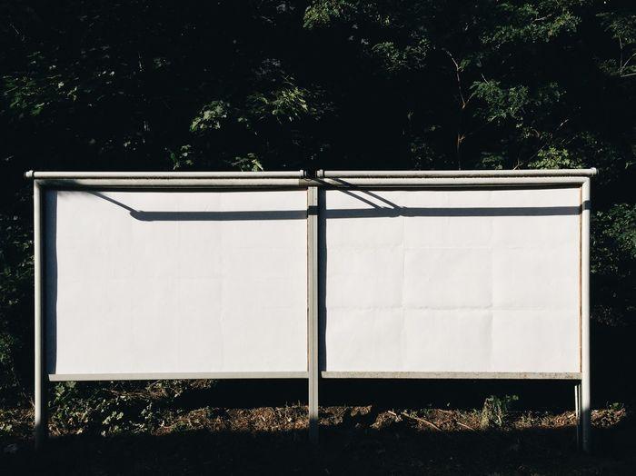 Blank billboard by street