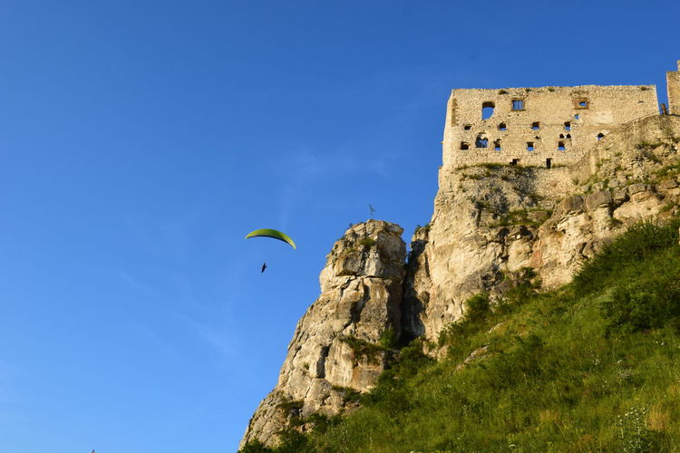 History Castle Spissky Hrad Architecture Parachute In The Sky Outdoors Flying Travel Destinations Sky Blue Nature Clear Sky Beauty In Nature