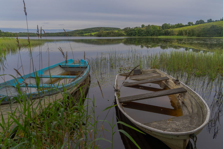 A beautiful lake and rowing boat in Ireland. Fresh Water Lake Ireland Rowing Boat And Lake Calm Water Tranquil Scene Tranquility Scene Fishing Tourist Attraction  Tourism Nature Nature Photography Natural Beauty Green Nature Scenic View
