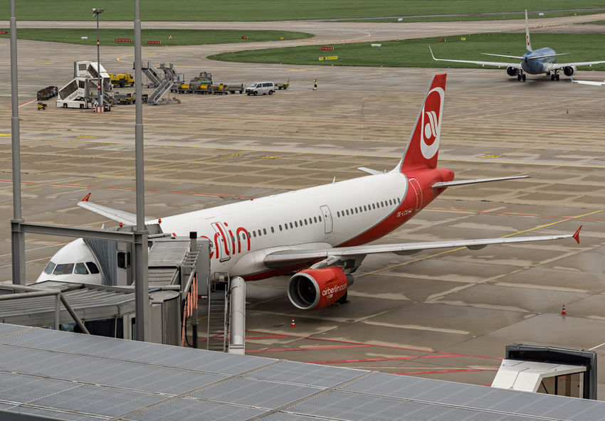 A plane of Air Berlin at the airport in Leinfelden-Echterdingen Business Aerospace Industry Air Berlin Air Vehicle Airfield Airplane Airport Airport Runway Bankrupt Commercial Airplane Day Financial Crisis Flying Mode Of Transport News No People Outdoors Red Runway Transportation Travel