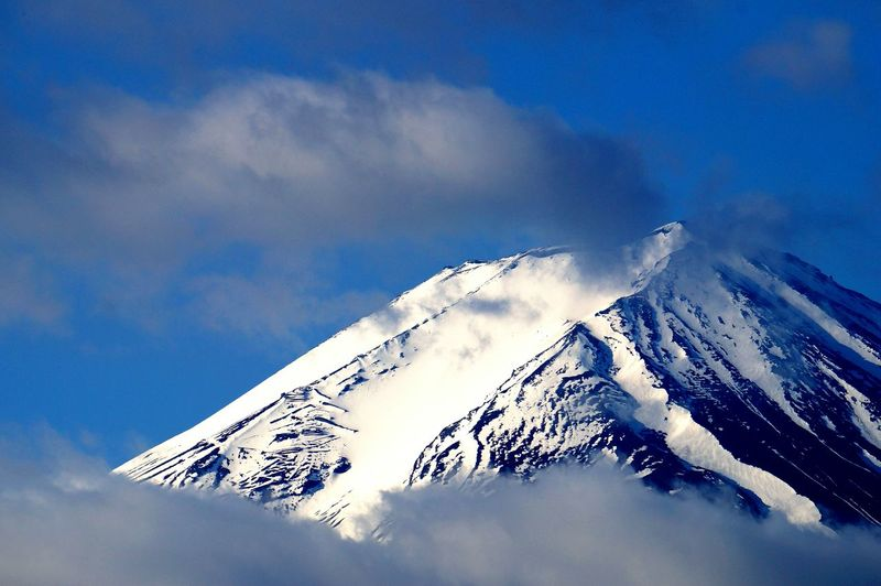 Low Angle View Of Mount Fuji Against Cloudy Sky