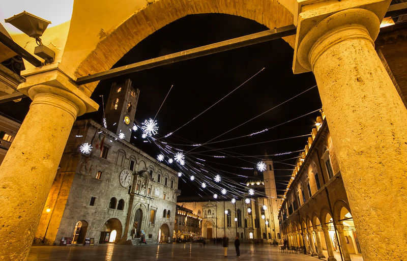 The main square of Ascoli Piceno (Piazza del Popolo) at christmas time, Italy Ascoli Piceno Celebration Christmas Christmas Lights Holidays Merry Christmas! Ornament Square Arch Architectural Column Architecture Building Exterior Built Structure Card City Decoration Festive Illuminated Italy Low Angle View Night Piazza Del Popolo Traditional Travel Destinations Wallpaper