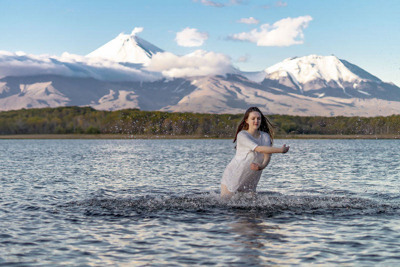 Beauty In Nature Day Lake Leisure Activity Lifestyles Mountain Mountain Range Nature Non-urban Scene One Person Outdoors Real People Scenics - Nature Sky Tranquility Water Waterfront Women Young Adult Young Women