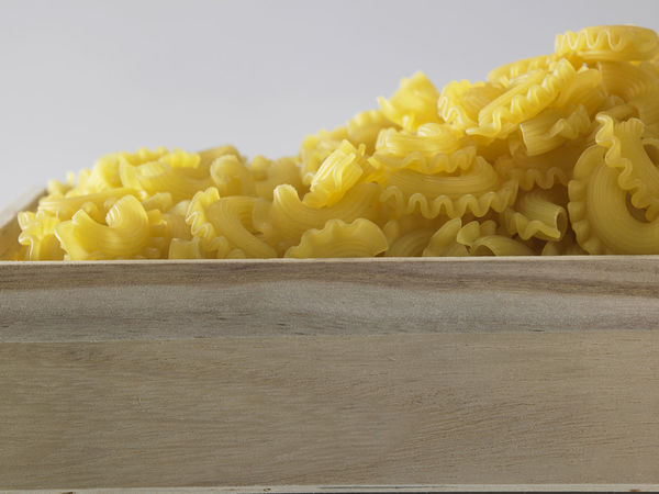 creste di gallo pasta on the white background Box Container Noodles Carbohydrate - Food Type Close-up Crate Creste Di Gallo Food Food And Drink Freshness Healthy Eating Heap Indoors  Ingredient Italian Food Large Group Of Objects No People Pasta Raw Food Spaghetti Still Life Table White Background Wood - Material Yellow