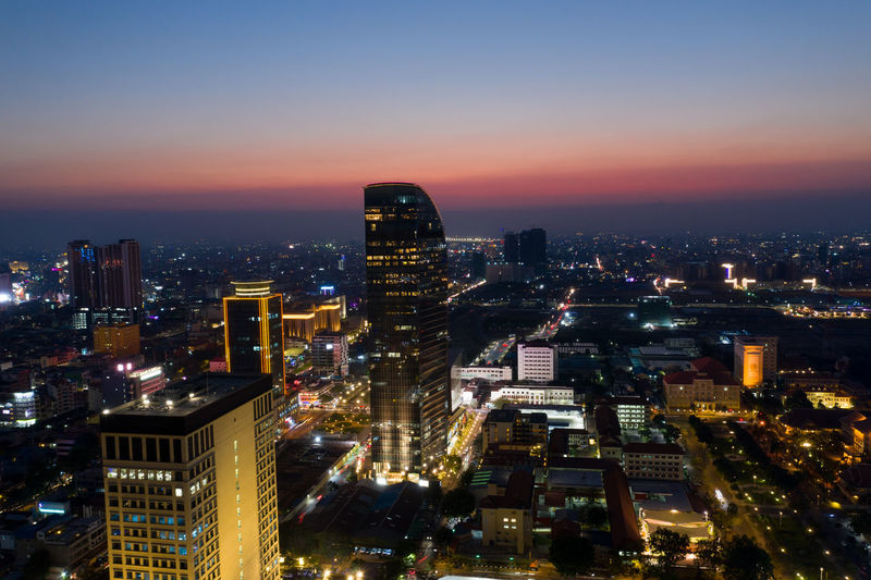 Phonmpenh landscape at sunset - Phnompenh is a capital of Cambodia Kingdom . Building Exterior Cityscape City Architecture Illuminated Night Skyscraper Office Building Exterior Built Structure Building City Life Modern No People Outdoors Phnompenh Cambodia ASIA City Cityscape Sunset Landscape Landmark Midnight Sky