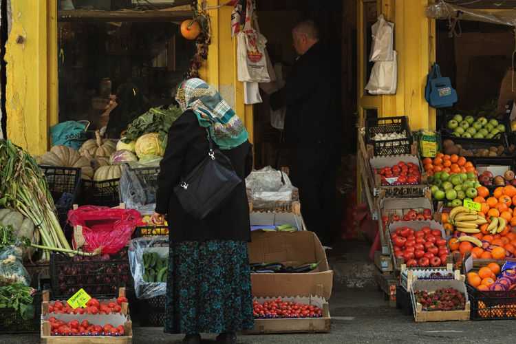 Women Standing Fruit Stall