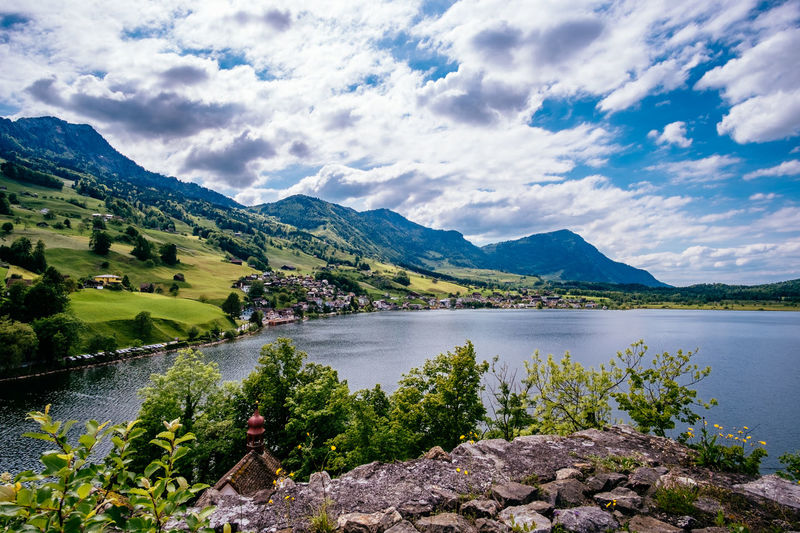 Beauty In Nature Cloud - Sky Day Growth Idyllic Lake Landscape Mountain Mountain Range Nature No People Outdoors Plant Scenics Sky Tranquil Scene Tranquility Travel Destinations Tree Water