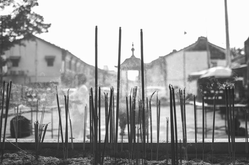 a bunch of joss stick in front the budish tempel Black And White Blackandwhite Budishm Budist Tempel Burn Chinese Chinese Culture Chinese New Year Chinese Style Day Joss Sticks No People Outdoors Place Of Worship Smoke Stick