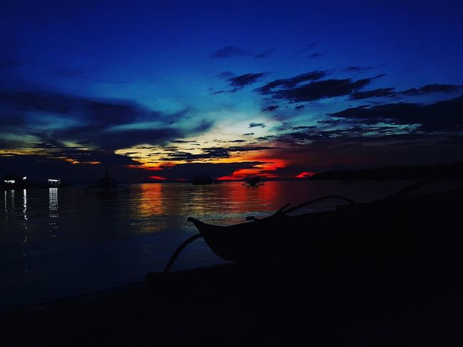 Colored sunset Sea Water Reflection Night Sunset Cloud - Sky Multi Colored No People Sky Outdoors Beach Scenics Vacations Red Nature Horizon Over Water Landscape Beauty Philippines Night Photography Nightlights Astronomy Travel Destinations Vacations Summer The Week On EyeEm EyeEmNewHere