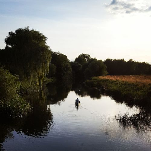 High Angle View Of Man Canoeing Against Sky