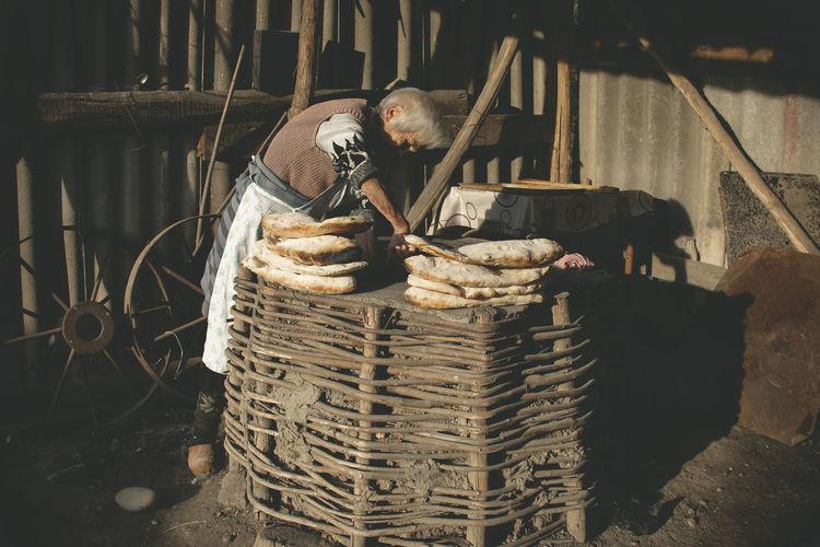 Stack of man sitting in basket