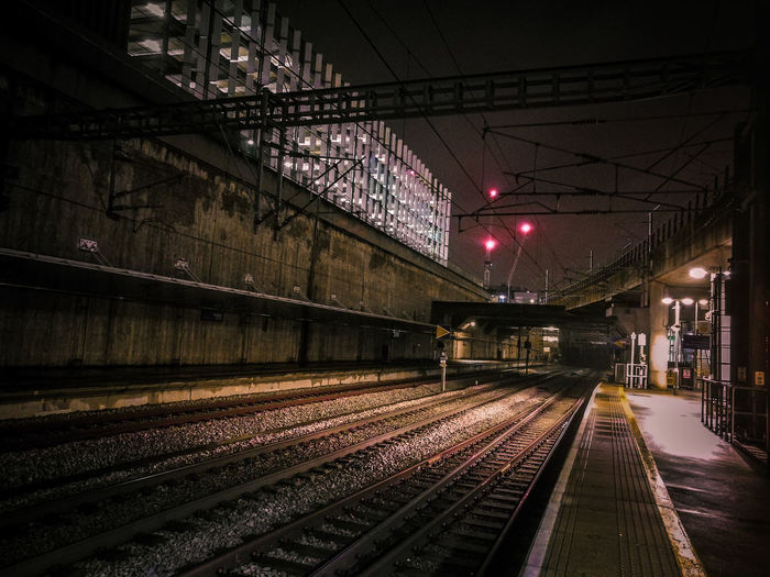 Empty railroad station platform at night