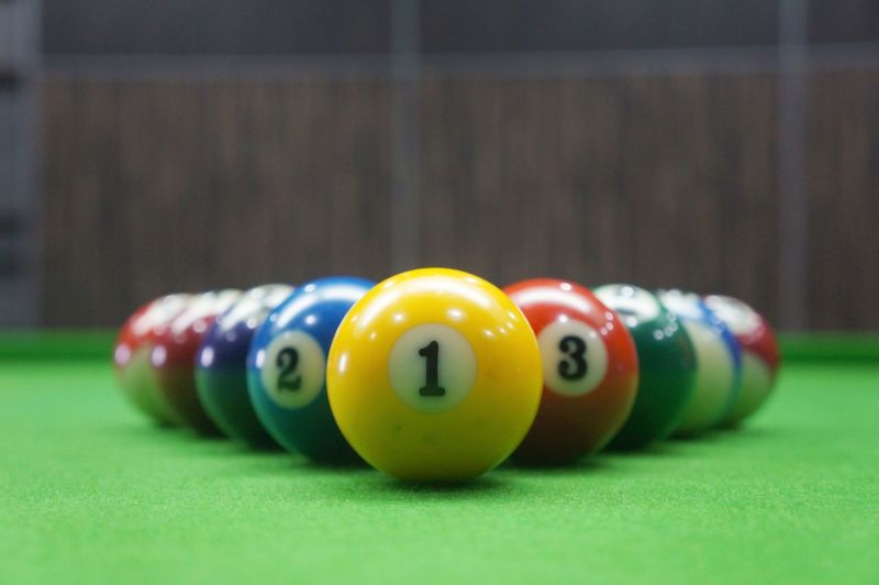 Multi-colored pool table Pool Ball Pool - Cue Sport Pool Table Snooker Pool Cue Sport Multi Colored Close-up Snooker Ball Sports Equipment Cue Ball Krakow Pool Ball Racket Sport Pool Hall Snooker And Pool Sports Target Leisure Games Marbles Board Game