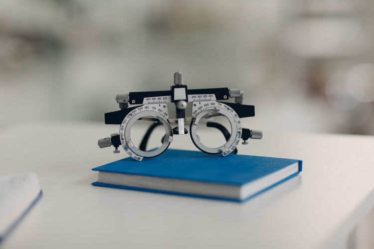 Close-up of eye test equipment on book