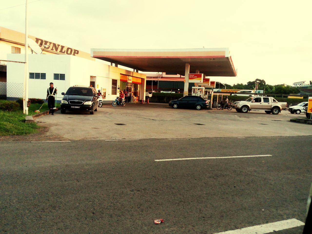 land vehicle, transportation, car, mode of transport, sky, outdoors, no people, day, fuel pump, gas station, architecture